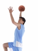 Young man with basketball, preparing to throw ball - blueduck