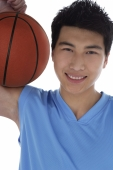 Young man with basketball, smiling - blueduck