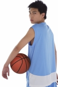 Young man with basketball, looking over shoulder - blueduck