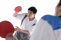 Young men playing table tennis - blueduck