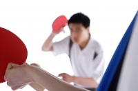 Two men playing table tennis - blueduck
