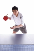 Young man playing table tennis - blueduck