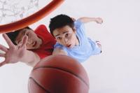 Two men playing basketball, shooting at hoop - blueduck