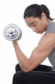 Man performing bicep curl with dumbbell - blueduck