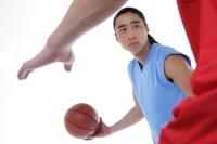 Two men playing basketball, studio shot - blueduck