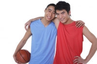 Two basketball players, with arms around each other, looking at camera - blueduck