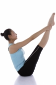 Female gymnast holding her ankles, stretching - blueduck