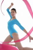 Woman performing rhythmic gymnastics with ribbon - blueduck