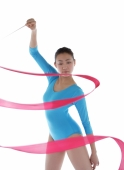 Woman holding ribbon, performing rhythmic gymnastics - blueduck