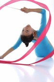 Rhythmic gymnastics, female gymnast doing routine with ribbon - blueduck