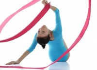 Rhythmic gymnastics, woman doing routine with ribbon - blueduck