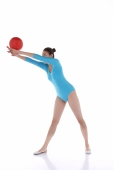 Gymnast performing rhythmic gymnastics with ball - blueduck