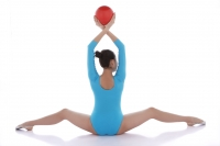 Gymnast performing rhythmic gymnastics, rearview - blueduck