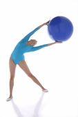 Gymnast exercising with fitness ball - blueduck