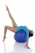 Gymnast balancing on fitness ball - blueduck