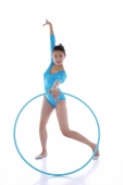 Rhythmic gymnast performing with hoop - blueduck