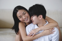 Couple embracing, woman smiling at camera - Yukmin