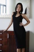 Young woman in black dress, hand on hip - Yukmin