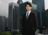Businessman looking at camera, buildings in the background - Yukmin
