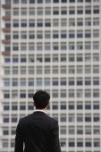 Businessman looking at building, rear view - Yukmin