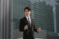 Businessman listening to MP3 player - Yukmin
