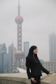 Woman looking away, Oriental Pearl TV Tower in the background - blueduck