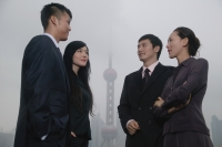Business people talking, Oriental Pearl TV Tower in the background - blueduck