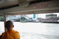 Buddhist monk on river boat taxi, Chao Praya River, Thailand - Yukmin