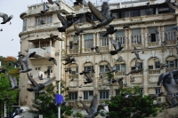 Building in Mumbai, India, birds flying in foreground - Yukmin