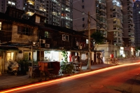 Apartment Buildings at night in Shanghai, China - Yukmin