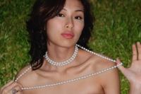 Woman wearing necklace, looking at camera - Yukmin