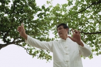 Man in park doing Tai Chi - Yukmin