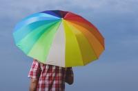 Man under rainbow umbrella, back to camera - Yukmin