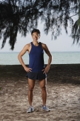 Man standing by beach after running, workout - Yukmin