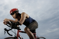 Man on bike racing, workout, wearing helmet - Yukmin