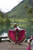 Woman in ethnic costume of Tibet, Xiongmaohai (Panda lake), Jiuzhaigou scenic Area, Wuhang, China - OTHK