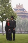 A couple walk in front of The Forbidden City, Beijing - Alex Mares-Manton