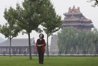 A woman stands in front of The Forbidden City, Beijing - Alex Mares-Manton