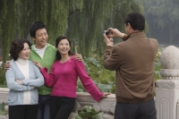A family pose for photos together while on vacation - Alex Mares-Manton