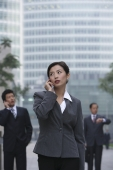 A businesswoman uses her cellphone - Alex Mares-Manton