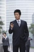 A businessman uses his cellphone - Alex Mares-Manton