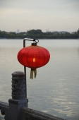 Chinese lanterns next to water - Alex Mares-Manton