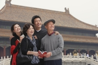 A family pose for photos together in front of The Forbidden City, Beijing - Alex Mares-Manton