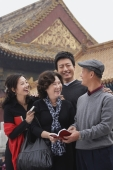 A family laugh together in front of The Forbidden City, Beijing - Alex Mares-Manton