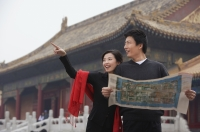 A tourist couple look at a map together in front of The Forbidden City, Beijing - Alex Mares-Manton