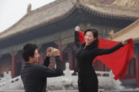 A couple take photos of each other in front of The Forbidden City, Beijing - Alex Mares-Manton