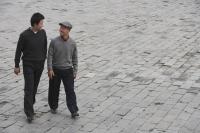 A grandfather and grandson walk together - Alex Mares-Manton