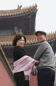 A man and a woman look back at the camera in The Forbidden City, Beijing - Alex Mares-Manton