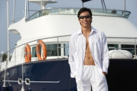 Man in front of yacht, smiling at camera - Yukmin