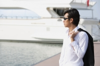 Man on pier, looking into distance - Yukmin